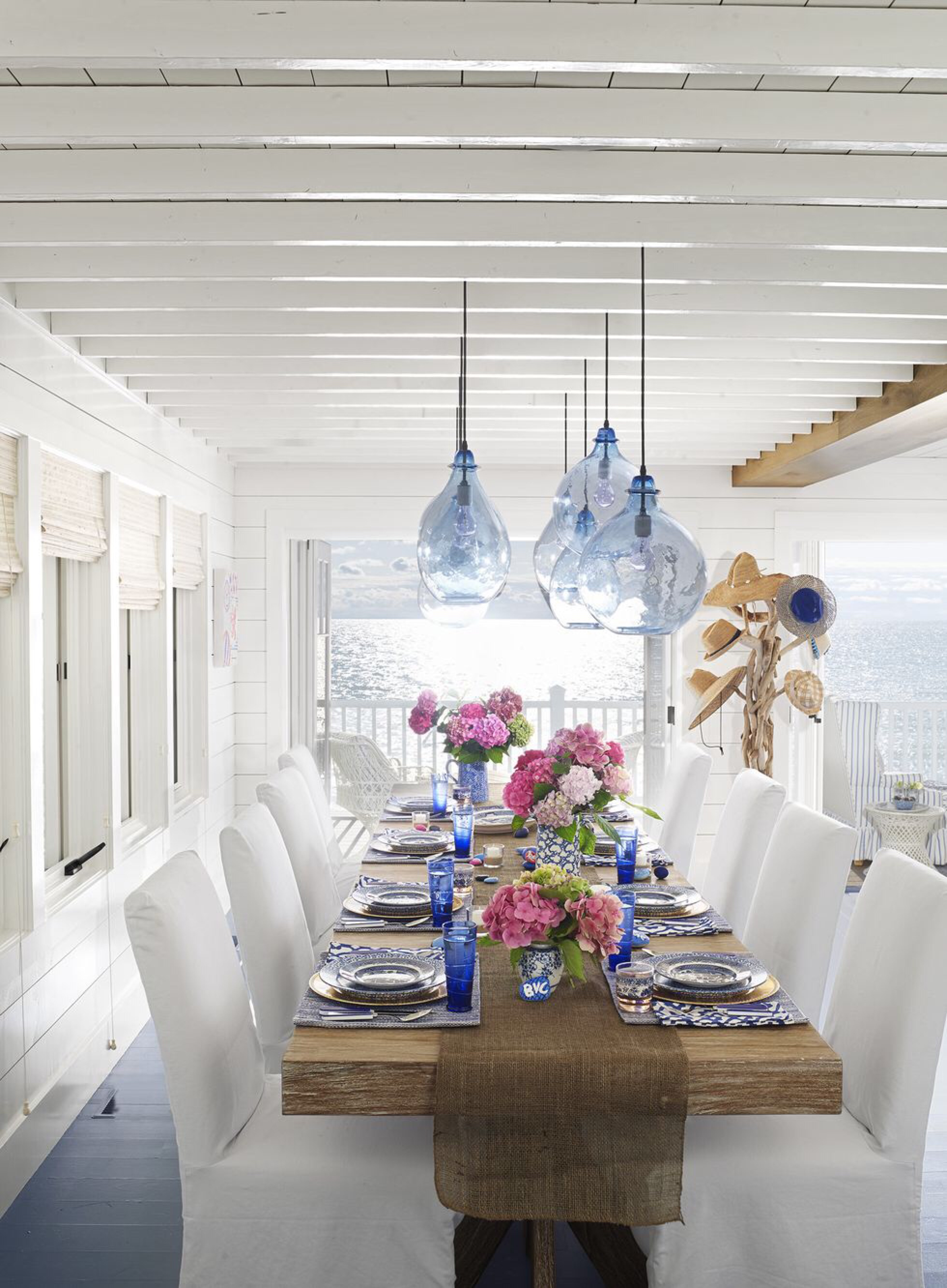dinner_dining_table_dining_room_lights_Article_from_House_Beautiful_summer_home_in_Ludington_Michigan_decor_decoration_blue_white_beach_decor_interiors_and_more_vacations_980_1332.jpg